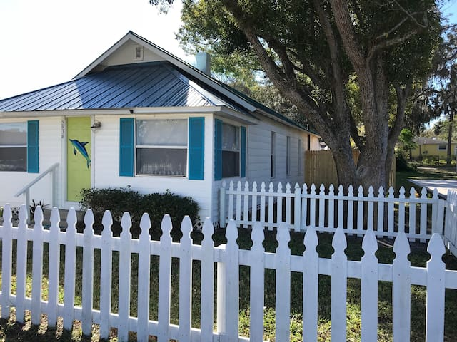 Enclosed white picket fence with two gates