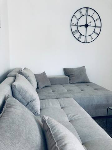 Large sofa in living room which turns into a double bed.