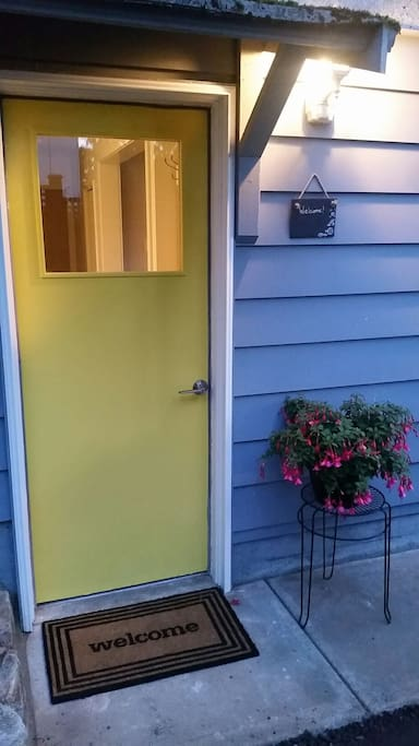 Private entrance and driveway for 2 vehicles, and of course a yellow door!