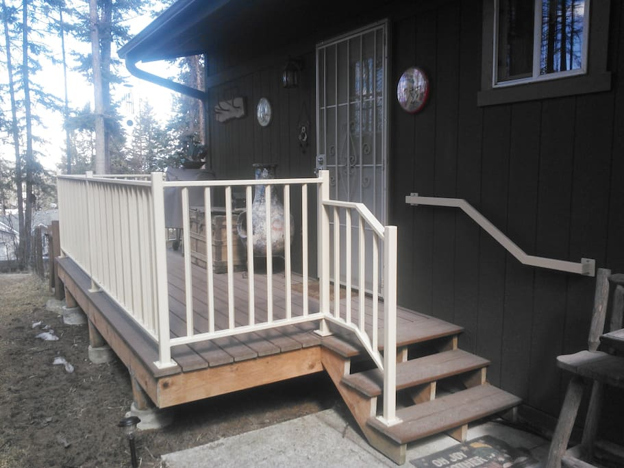 Easy access from paved driveway out front, around back on concrete walkway. Just three steps onto private deck.