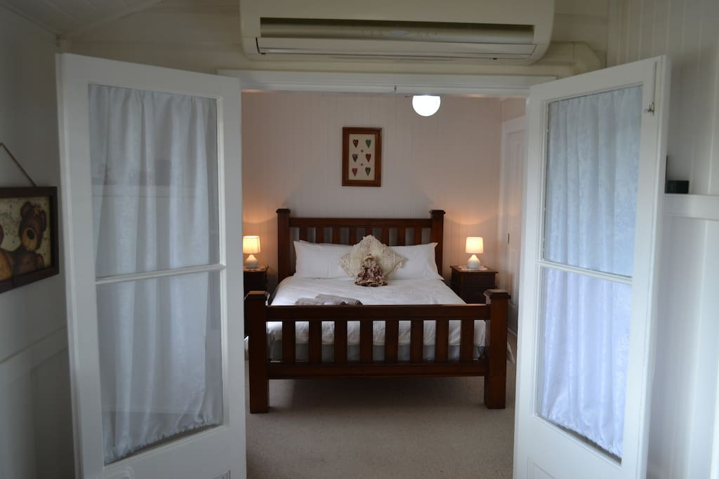 Cherry Blossom Cottage has its tradition country bedroom with 2 French doors as the entry! It is situated at the front of the house-just off the main entrance room
