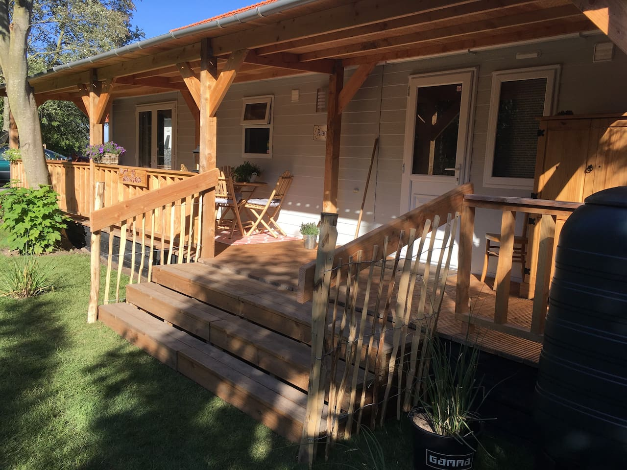 Great and very cosy chalet of 3,70 x 11,00 meters with a beautiful veranda on the edge of forest and lively coastal town.