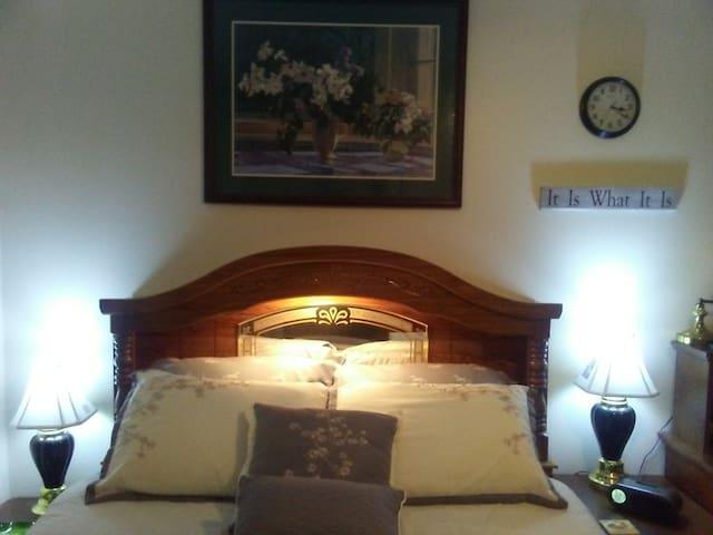 Queen Bed - Night tables Headboard Light On
