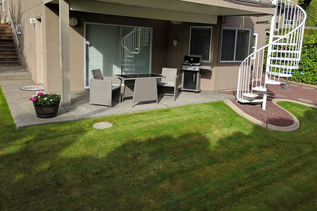 Summer is here... Enjoy the Weber BBQ & wicker furniture on the covered patio with southern exposed rear yard.