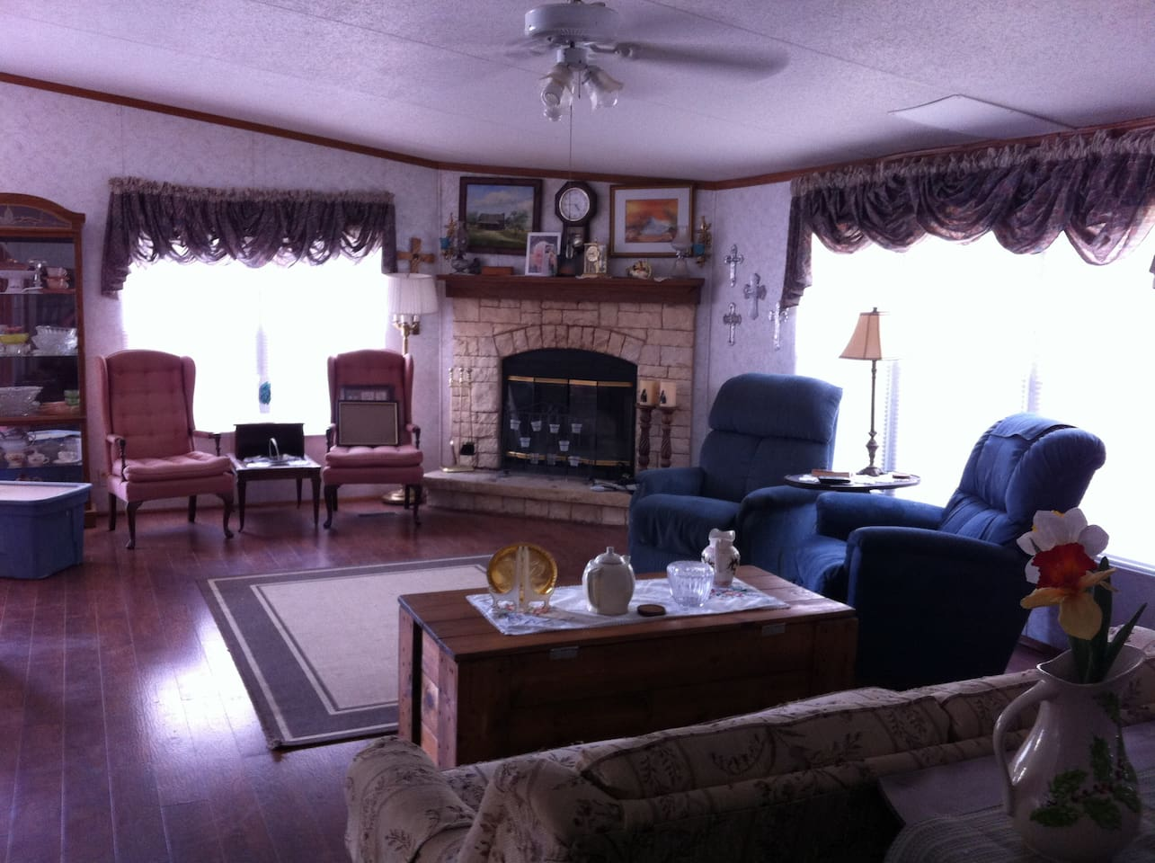 Comfortable sitting in living room - large TV, couch, recliners.