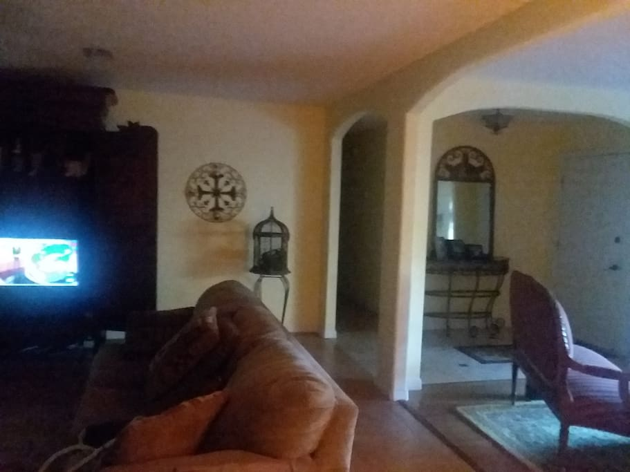 Family room offers very open floor plan, tv/dvd, queen sleeper, foyer and formal living to the right
