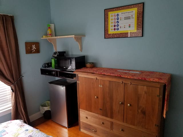 Mini-fridge,microwave,K cup style coffee maker, as well as dishes and utensils are provided.  Guest are welcome to enjoy their meals at the dining room table or either of the outdoor tables. There is a small portable bedside table in the room.