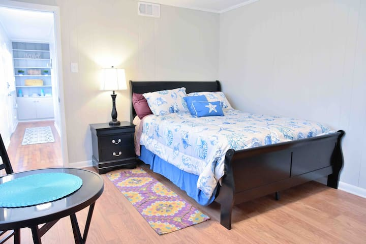 Queen size bedroom with memory foam mattress. Each bedroom is far enough away for privacy if traveling with a group.