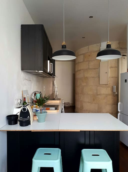 Kitchen with beautiful stone staircase core.