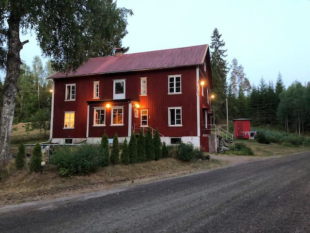 Large red house in naturenvironment