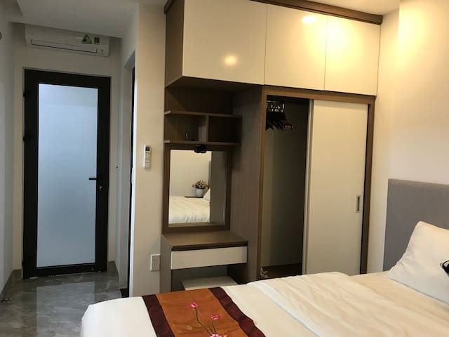 Main bedroom with closet, great aircon, makeup table, hangers