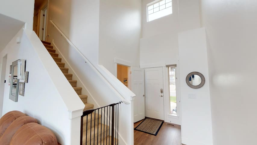 Entryway, baby gates on stairs easy to open or leave open