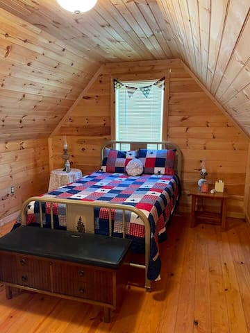 Loft Bedroom with Full bed, dresser, trunk and 2 night stands