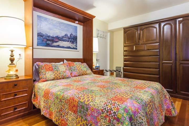 This is the bigger bedroom with plenty of closet space.  The Murphy bed is equipped with a thick memory foam mattress and can be folded up and the room used as an office or study.