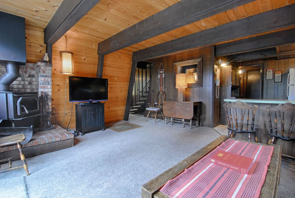 Living room with wood stove and Flat TV
