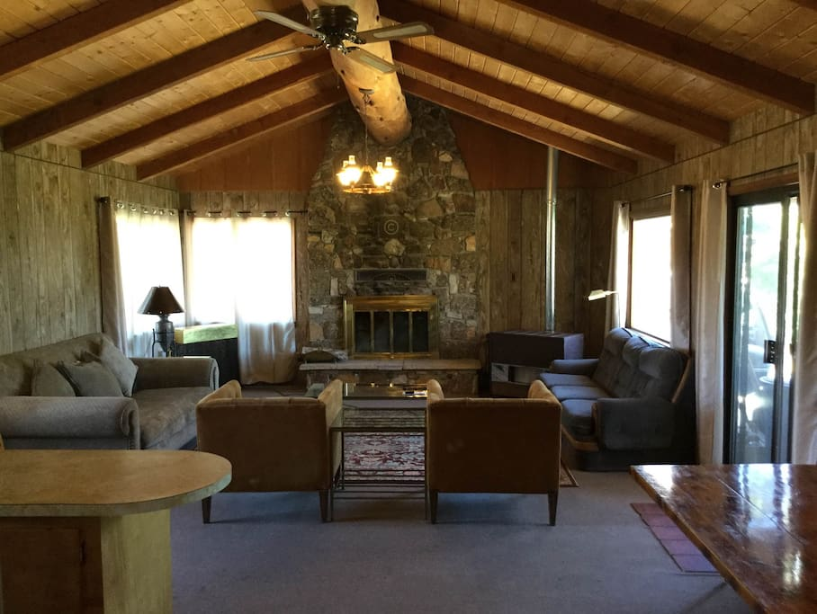 Giant living room which opens to the kitchen and dining room table area and has stellar mountain views!