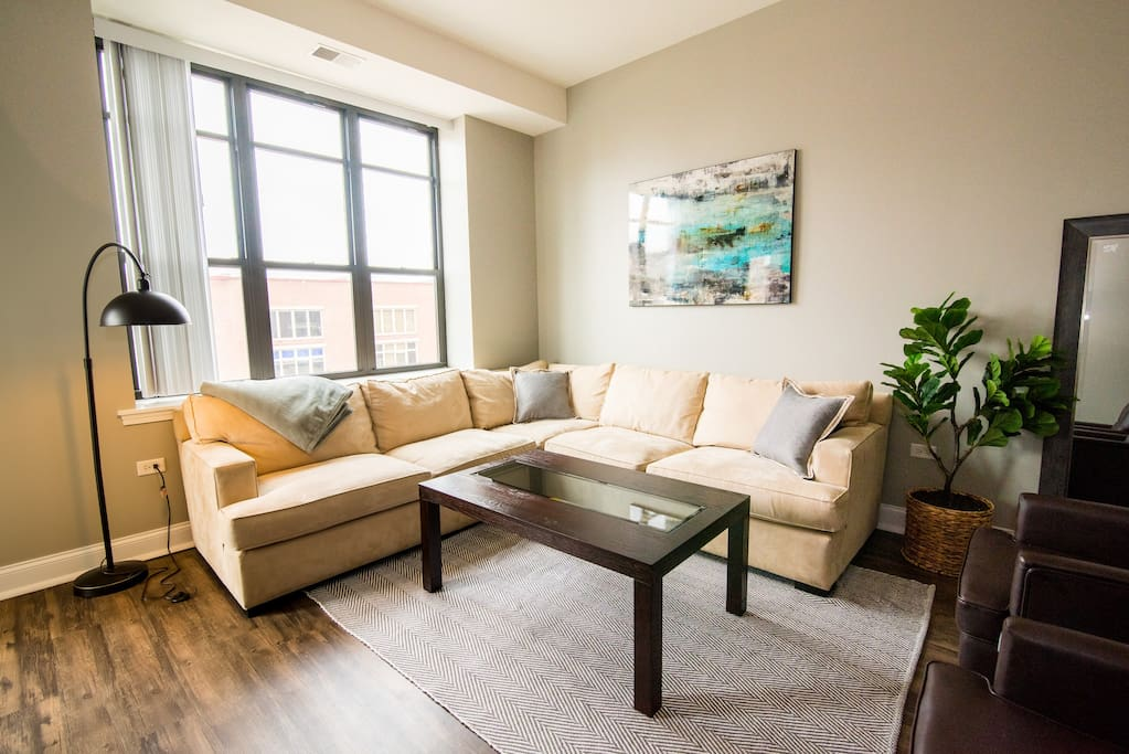 Enjoy our sun-lit living room with complimentary Netflix and DirecTV Now!