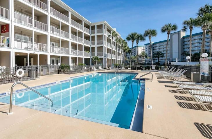 Ocean view condo with pool, hot tub, balcony.