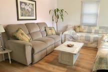 """Living Room is 12""""x17"""" it has a Twin bed & large Full Double  plus sofa with two fully reclining seats - comfy enough to sleep on"""