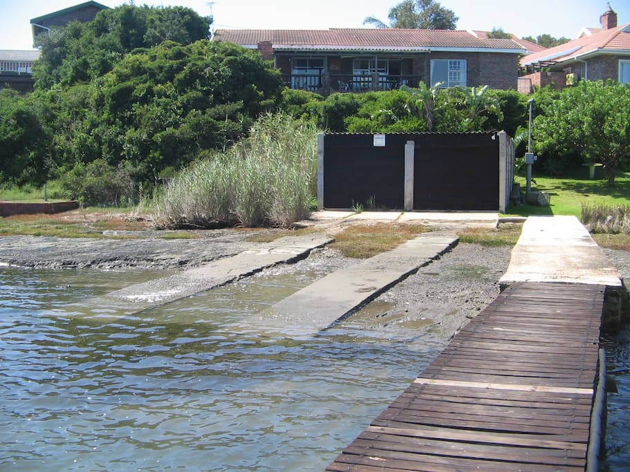 House on riverside with jetty and slipway