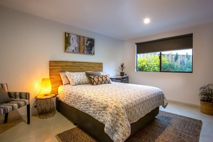 Queens size double bedroom with private garden outlook. Welcome to Wandoo Rest!