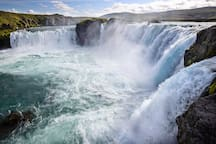 Goðafoss waterfall. Rjúpa Guesthouse is perfectly located if you want to experience the natural wonders of North Iceland. Goðafoss (the Waterfall of the heathen Gods of old, 25 km) is nearby,