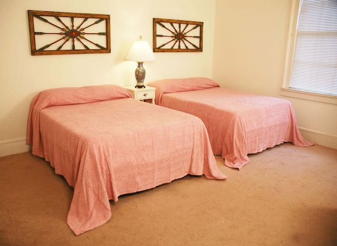 Master bedroom has two double beds with memory foam mattresses, chest of drawers, full length mirror, two closets.