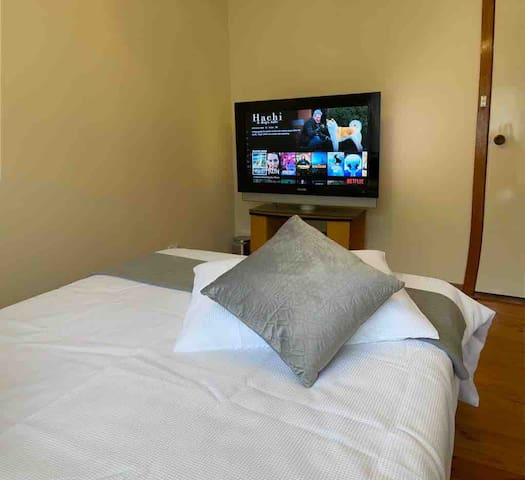 """Your Bedroom with 50"""" TV, Netflix, Prime Movies, YouTube etc.. A comfy double bed."""