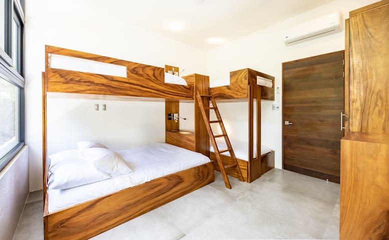bedroom 3 = fun bunk kids room, 1 queen bed and 3 twin beds