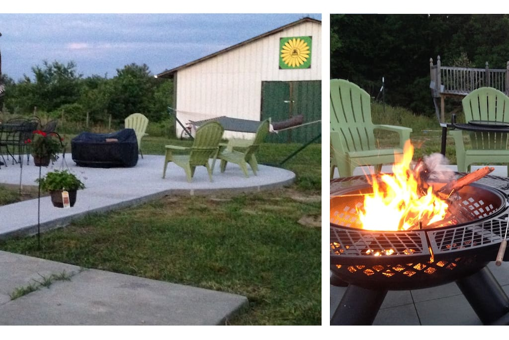 Round patio with amenities available for outdoor activities, with fire pit, seating and table.