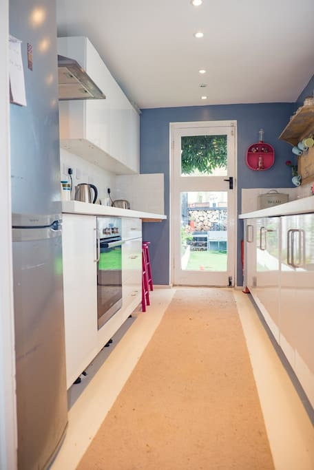 Well equiped kitchen leading onto private garden