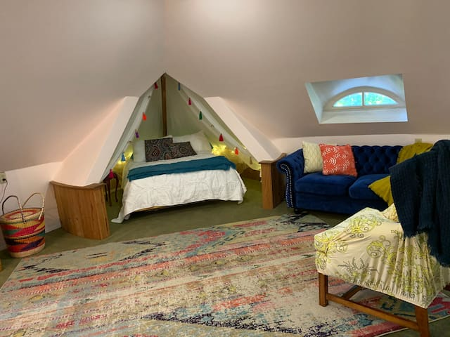 Second sleeping area, the teepee! Double bed surrounded by canopy and twinkle lights.