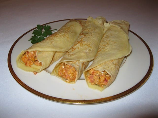 Crepes stuffed with eggs scrambled with tomato and basil