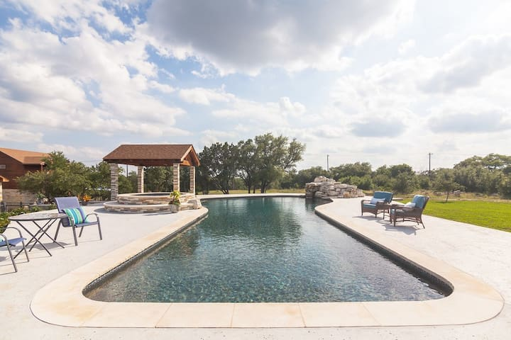 You are welcome to take a swim in this extra large pool or just lounge pool side.