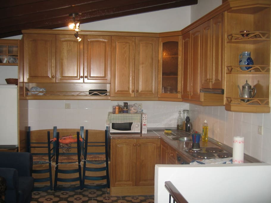 Upstairs kitchen (full place has been repainted - more photos forthcoming)