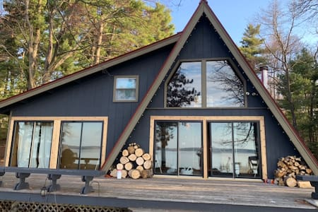Quirky Grindstone Lake A-frame with sandy beach