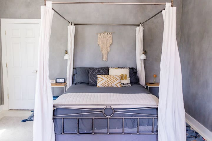 Queen bed with luxury sheets & canopy drapes for added comfort