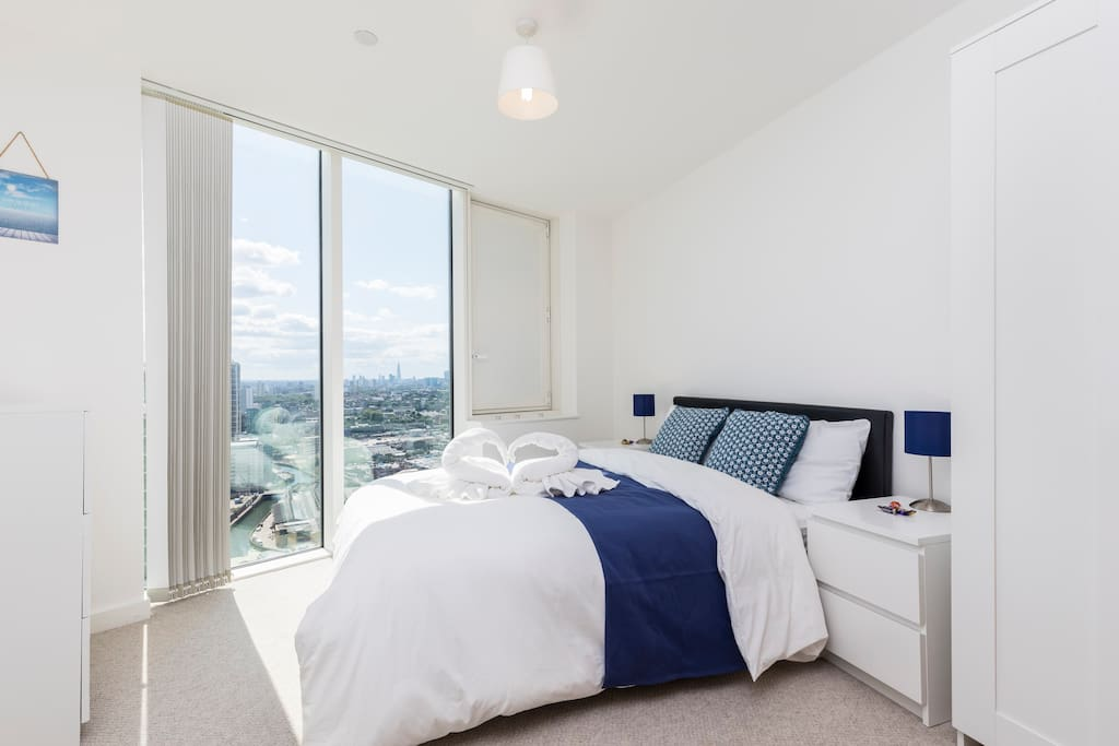 Bright bedroom with beautiful view of London