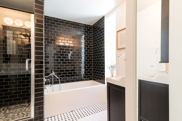 Upstairs, you will find a full bathroom with a stand up shower and bath tub.  The shower is stocked with cruelty-free, sulfate-free, shampoo, conditioner, and body wash.
