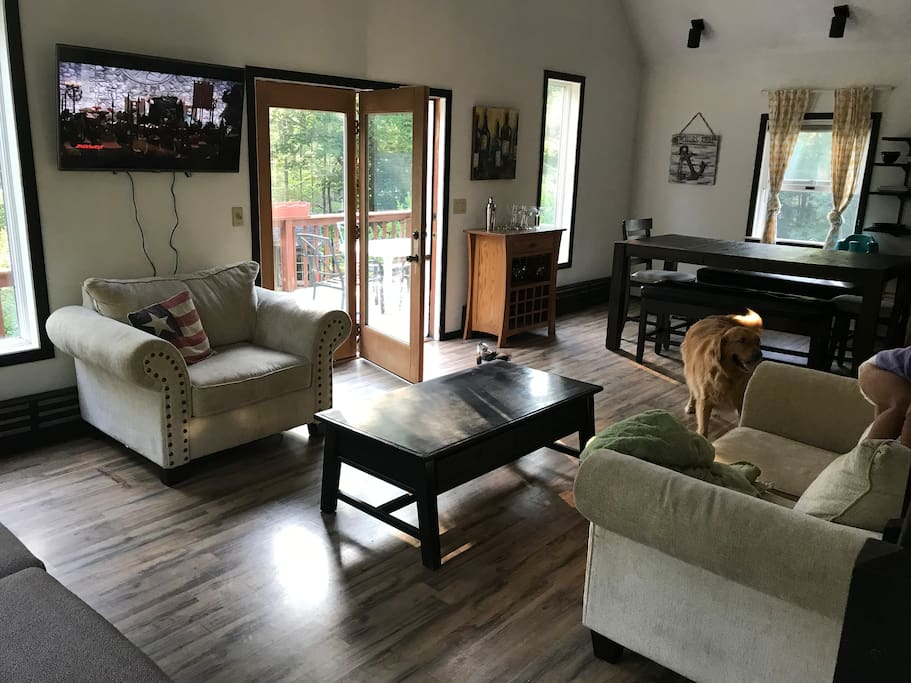 Living room- 1 loveseat, 1 oversized chair, one sleeper sofa (lower left side of picture) 50 in TV with full cable, also ready for your firestick.  Golden retriever not included- but we hope you bring your pets!