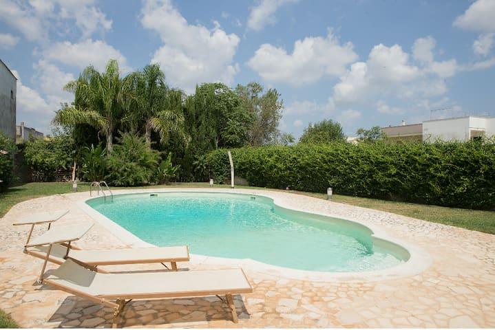 Taverna-appartamento con piscina