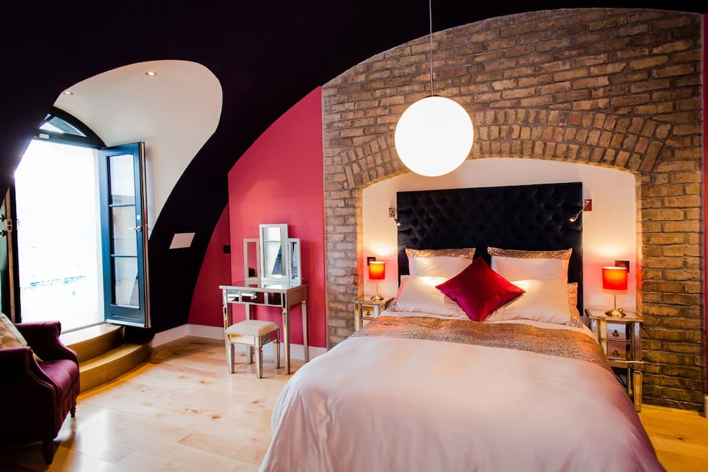 Stunning master bedroom with Cathedral dome shaped ceiling to accentuate original brick arch