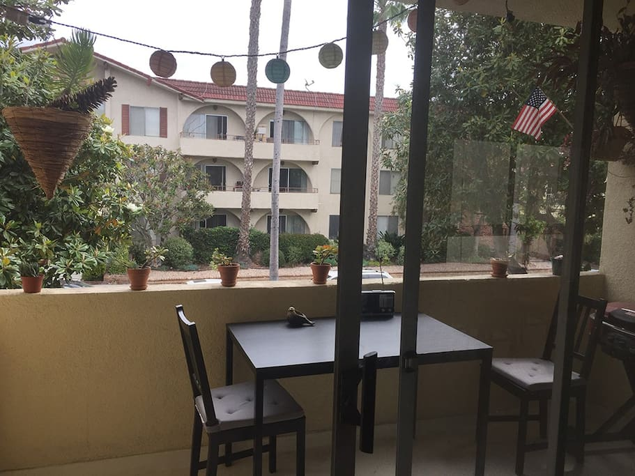Balcony with view of neighborhood. Gas grill you can use.