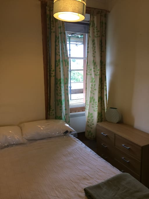 Bright, clean bedroom with double bed. Built in mirrored cupboards = excellent storage