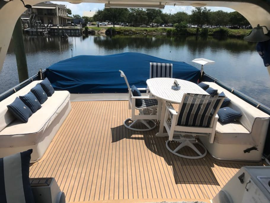 Looking aft, upper deck, easily seat many.  The area under the blue canvas is a bunny bed for sunning.