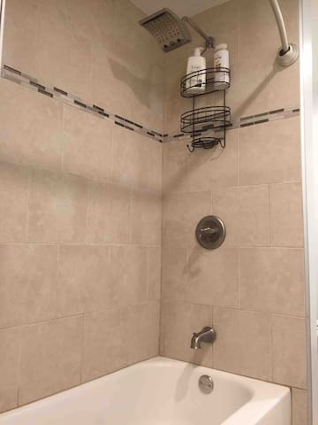 Bathroom - We offer towel, soap, toilet paper, shampoo, body wash, hairdryer, and curling iron.
