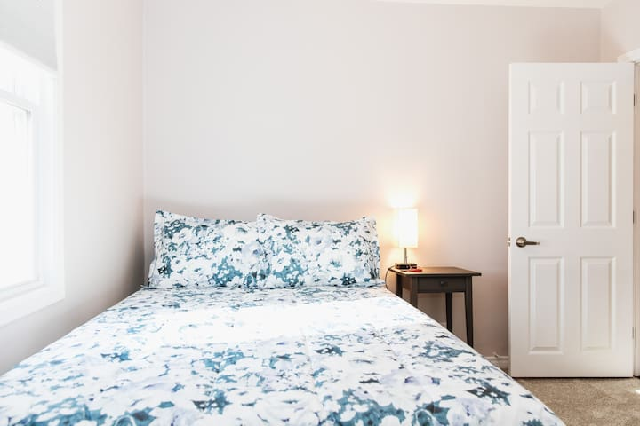 【Third Bedroom】  Great natural lighting, closet, ceiling fan, double bed.