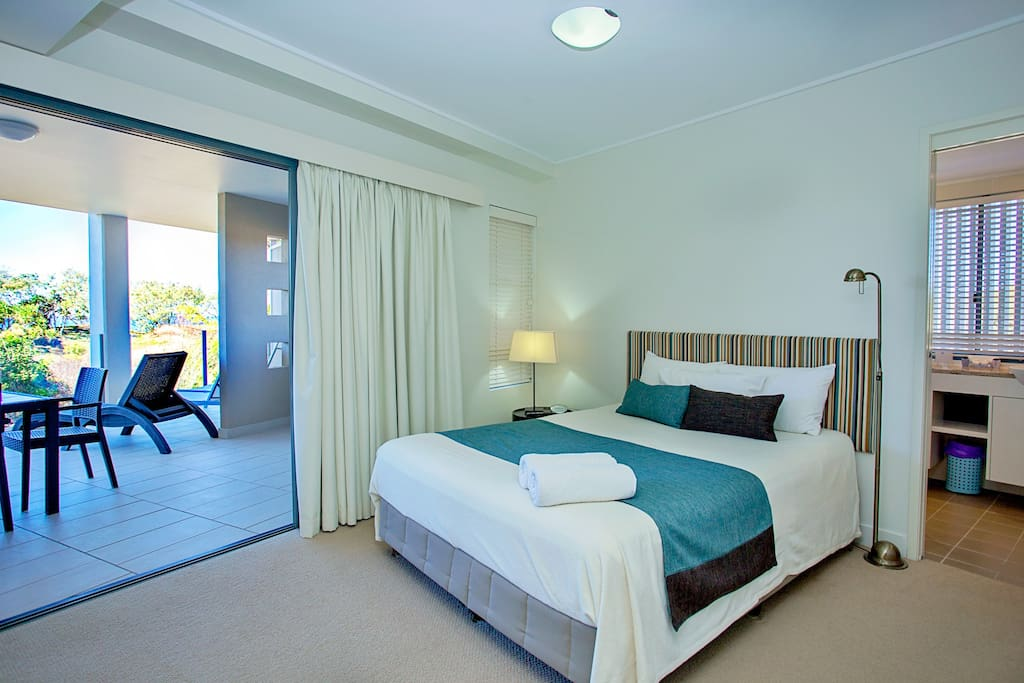 Large master bedroom with ensuite and balcony looking over the beachfront