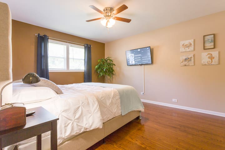 Bedroom #3. Queen Bed. The TV is a ROKU TV and has complimentary Youtube TV ready for you to enjoy.  Hangers and Luggage Racks are in each bedroom closet.