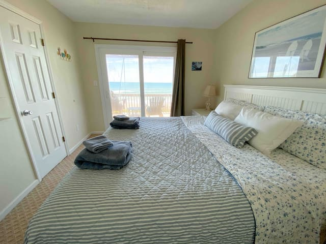 Two oceanfront bedrooms walk out to the lower deck, perfect for reading in the shade, relaxing and enjoying sunrise